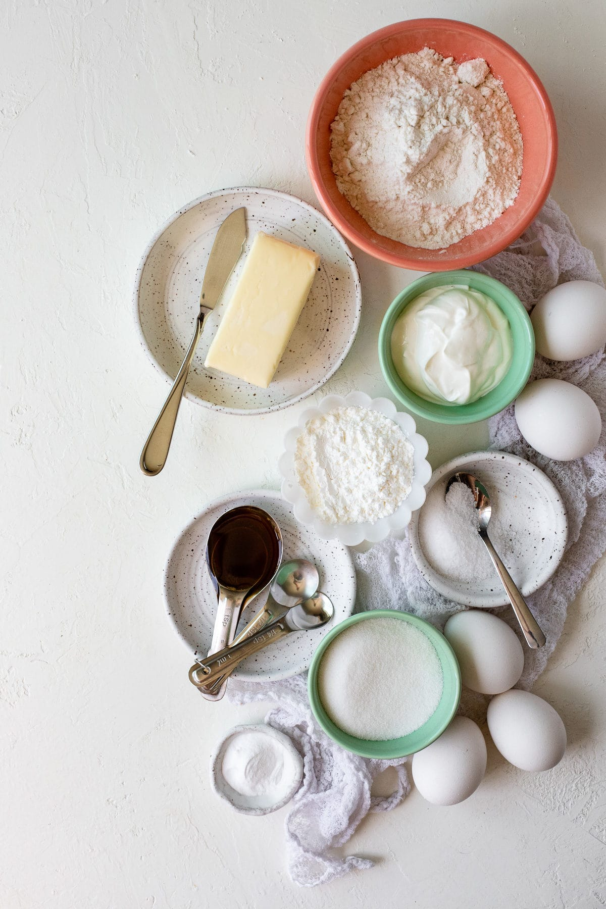 Overhead view of ingredients needed to make a sour cream pound cake.