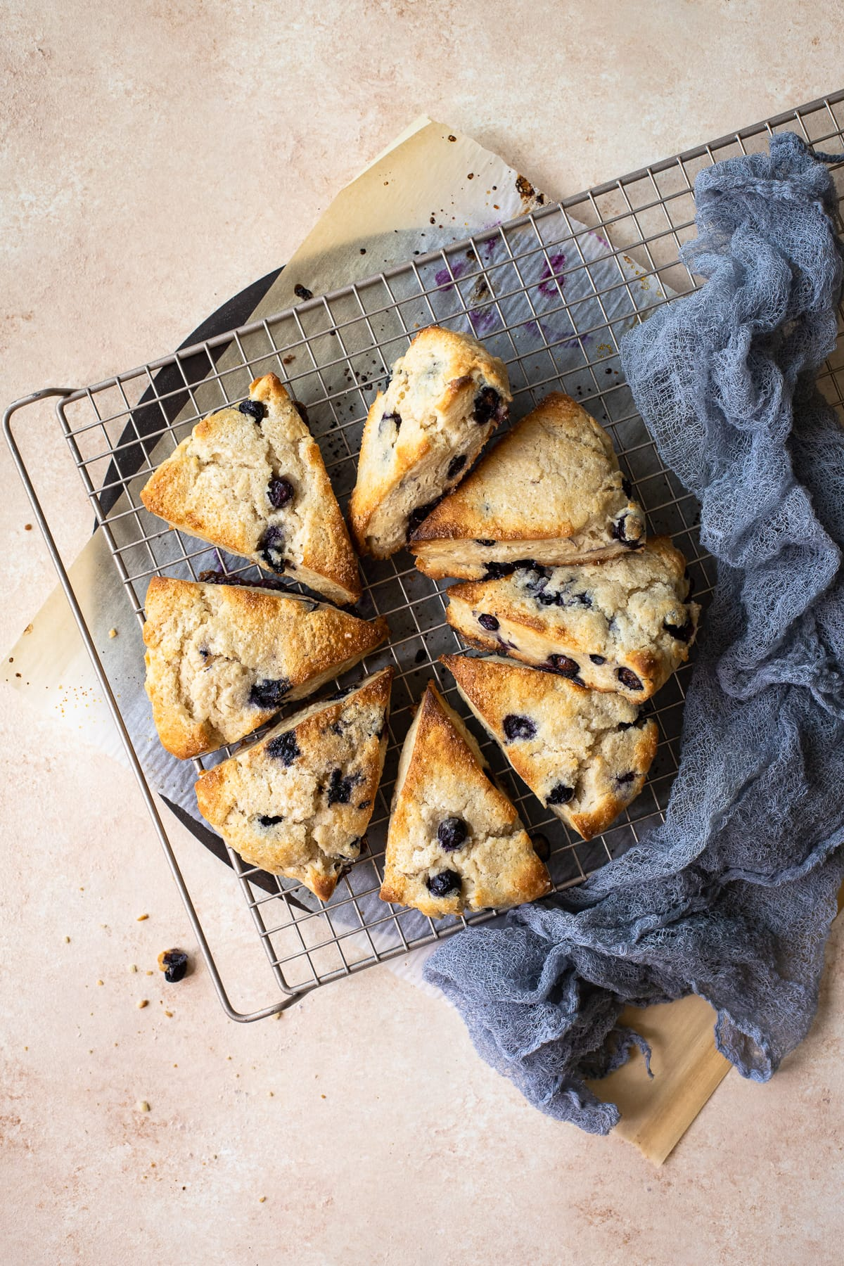 Blueberry scones cooling on a wire rack.