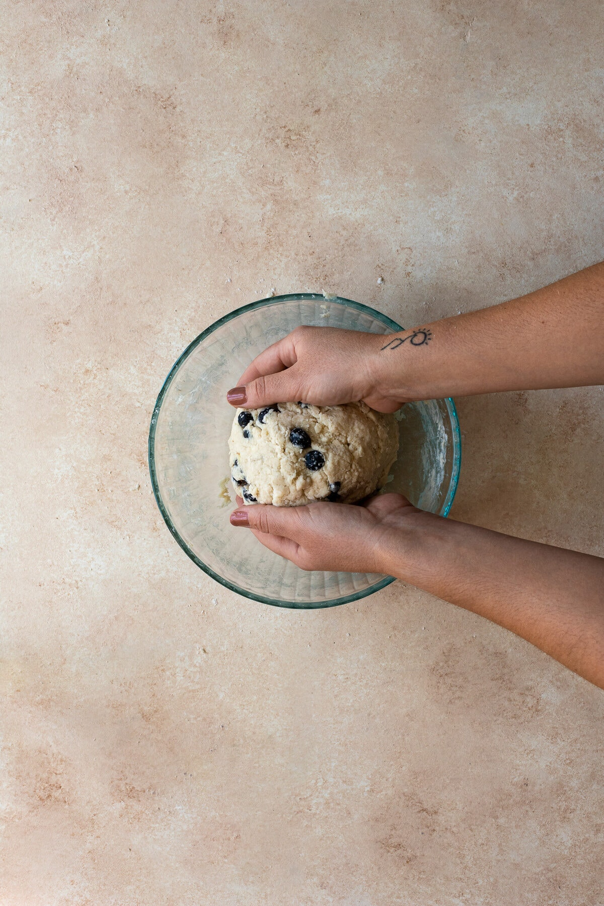 Process shot of kneading scone dough together.