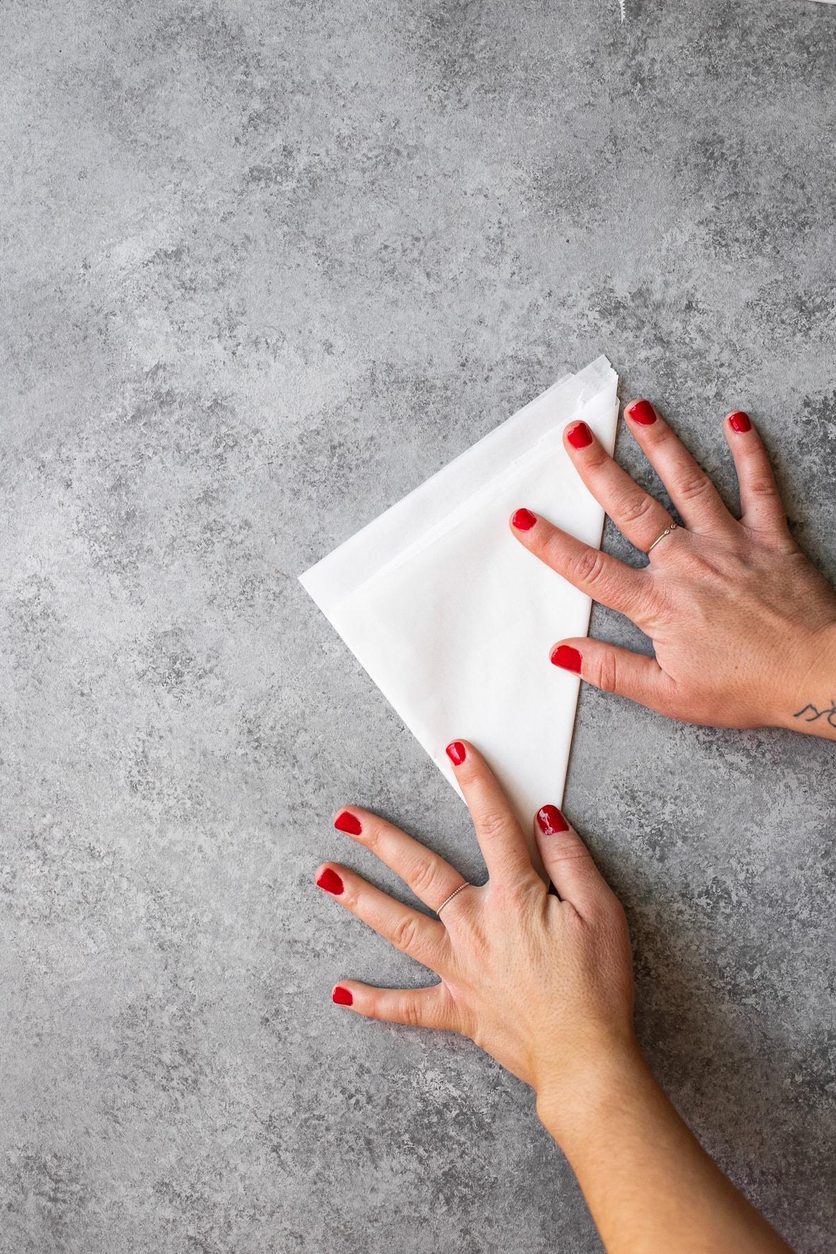 A piece of parchment folded into a triangular shape.