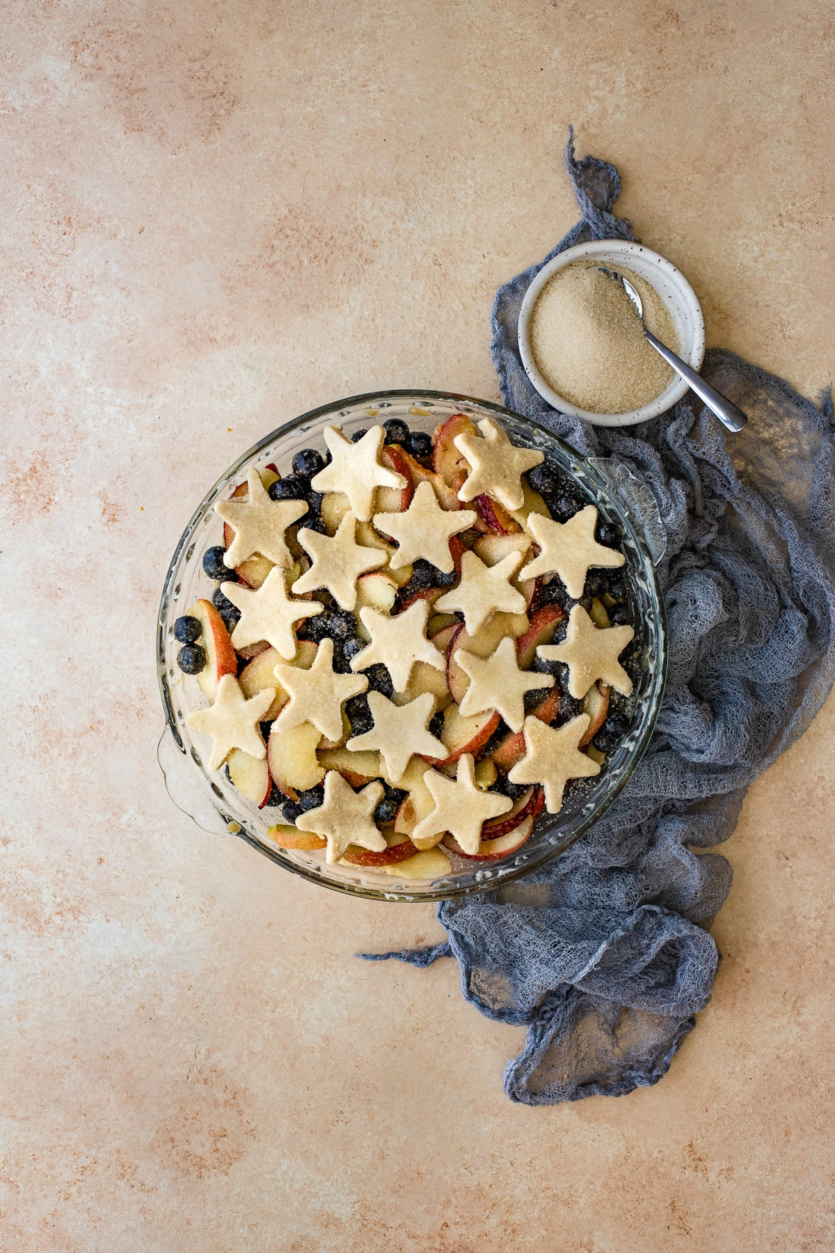 Cobbler prepped in a pie dish, ready to bake.