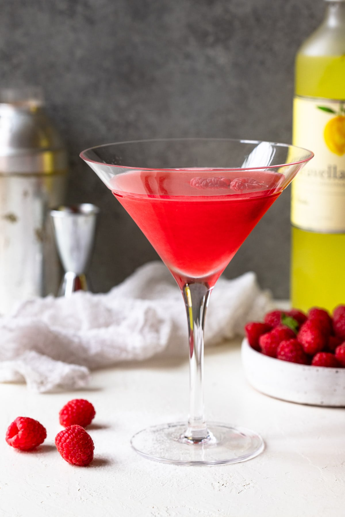 Raspberry limoncello vodka cocktail served in a martini glass.