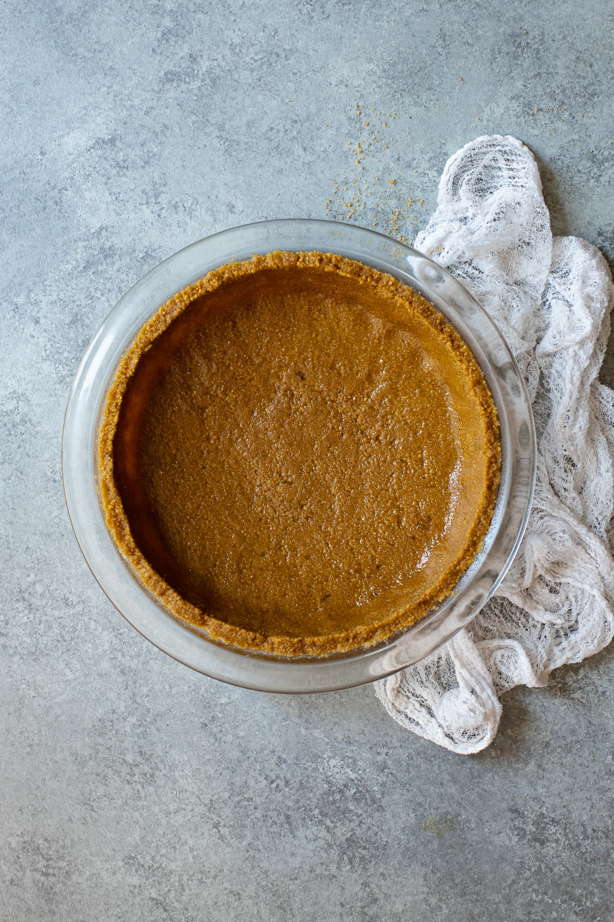 Graham cracker crust in a pie dish, pre-baked.