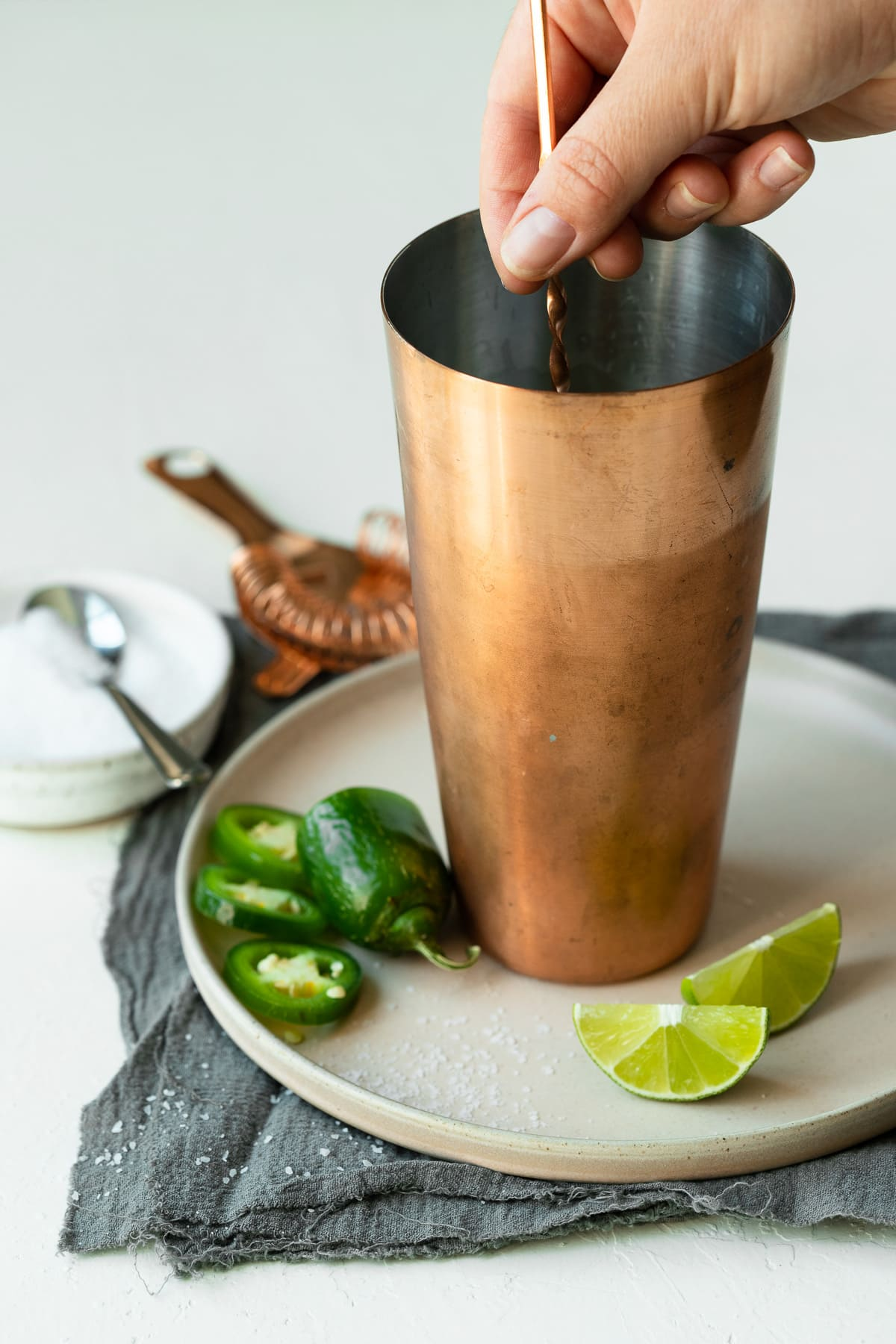 Margarita ingredients being stirred in a cocktail shaker.