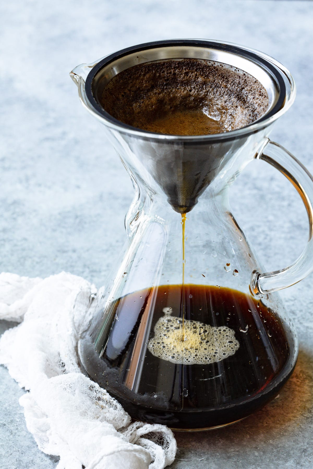 Cold brew being filtered through a pour over.